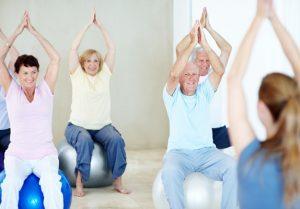 Older people using gym balls
